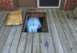 man in crawlspace
