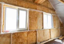 new insulation in attic of house with windows