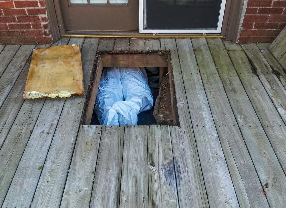 man in crawlspace