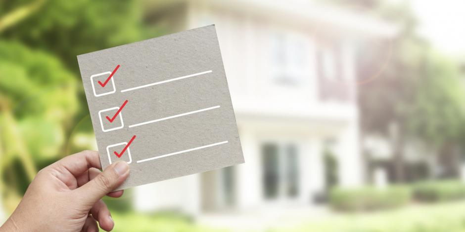 energy audit checklist concept, checklist in front of house exterior